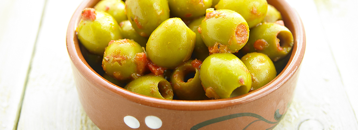 Marinated green olives with red pepper