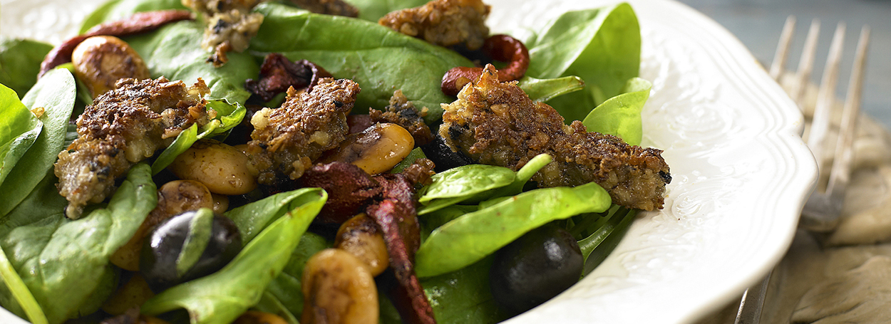 Vegetarian haggis with warm butter bean, pepper and spinach salad